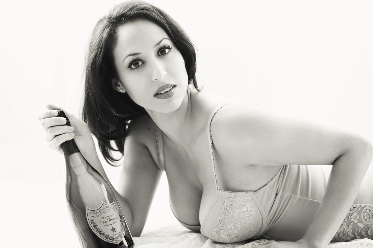 Celebrate you with a boudoir session in Vegas. Cheers!