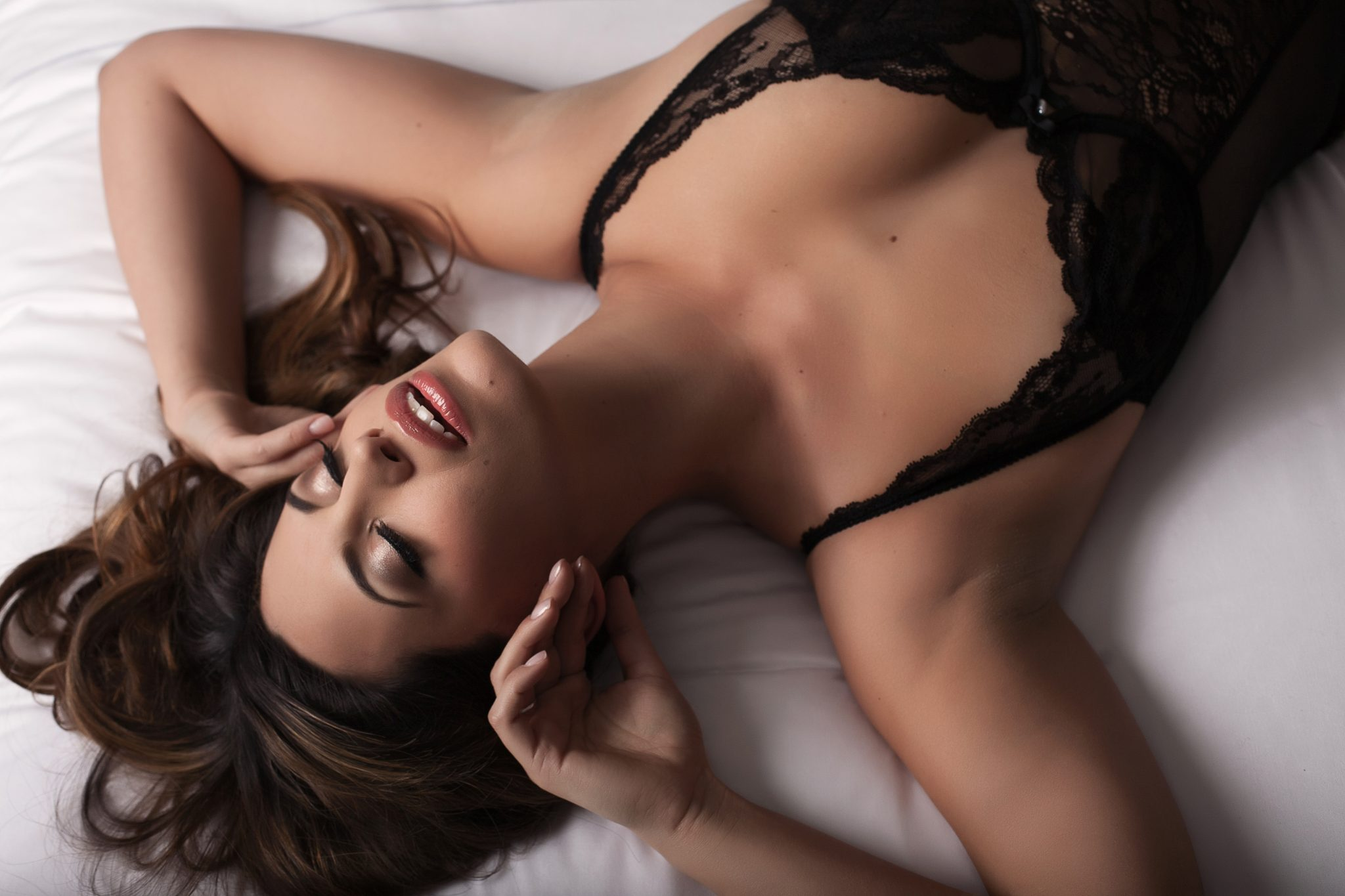 Our clients just glow during their boudoir sessions. Soft lighting by Haute Shots.