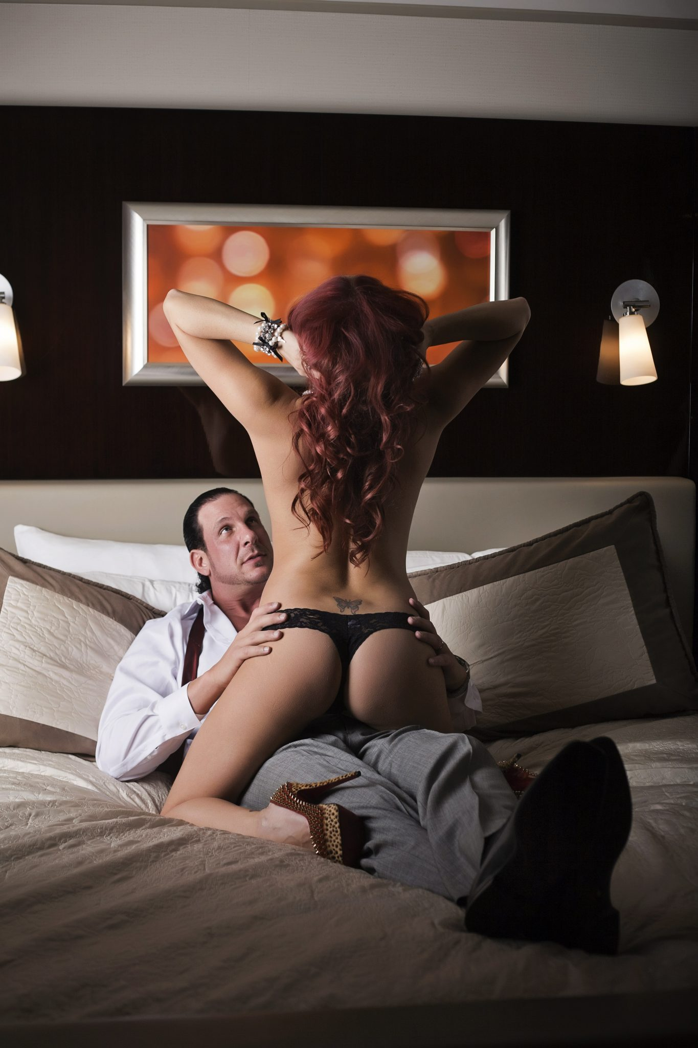 A sexy couple doing a boudoir shoot in vegas.