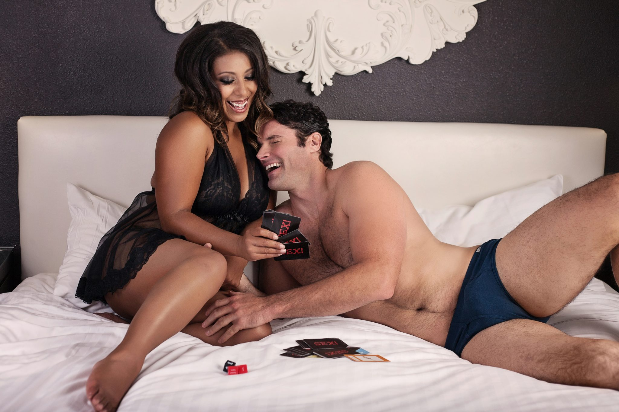 Couple having fun at boudoir photography shoot in Vegas.