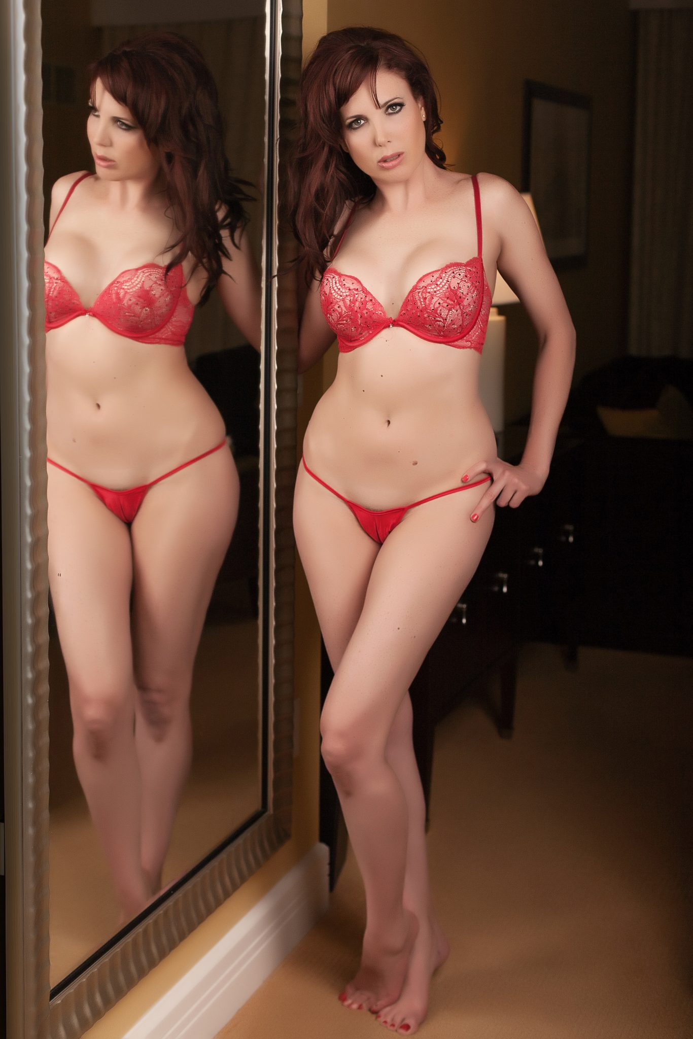 Reflection boudoir using a mirror in Vegas for boudoir shoot with Haute Shots.