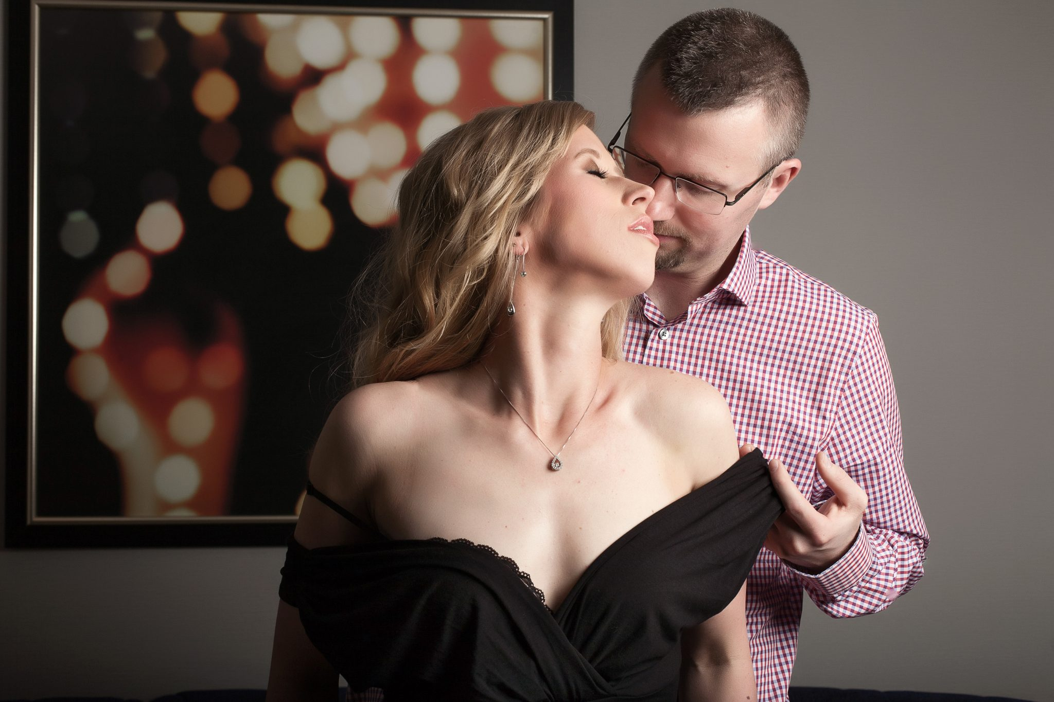 a married couple posing for boudoir photos in vegas.