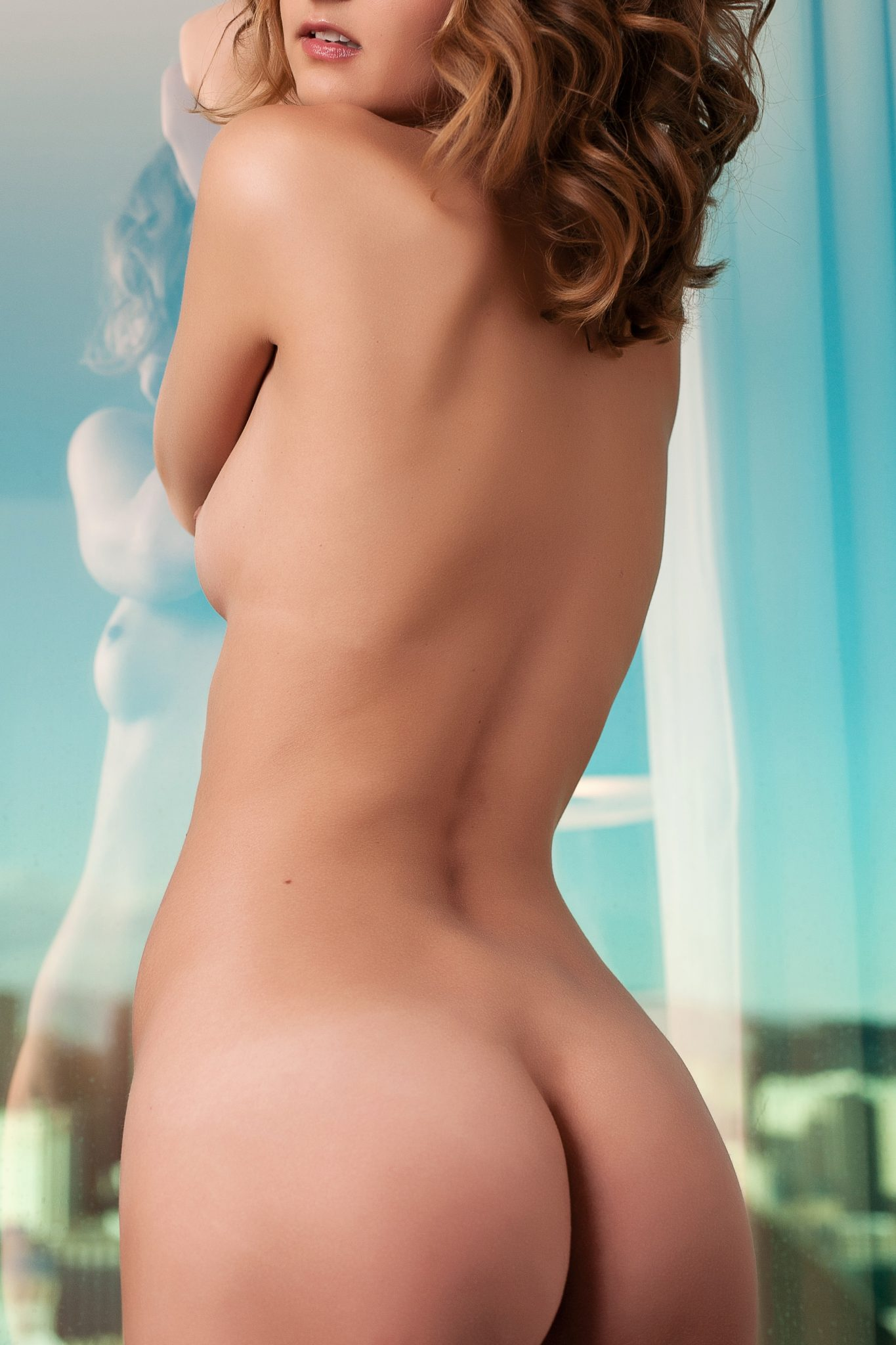 Lovely use of reflection in this fine art nude photo from a boudoir session by Stacie Frazier of Haute Shots in Vegas