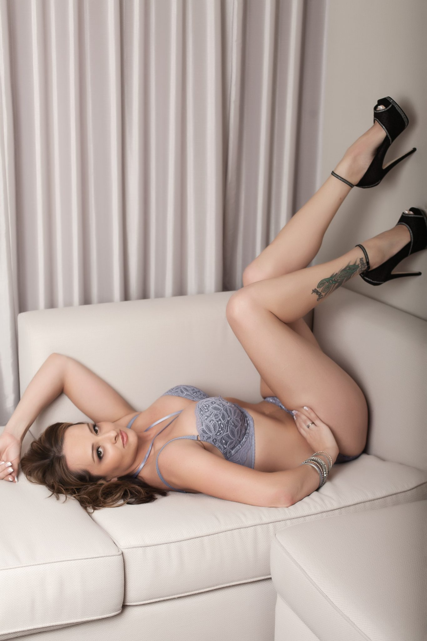 Showing off her long legs in this boudoir pose by Haute Shots.