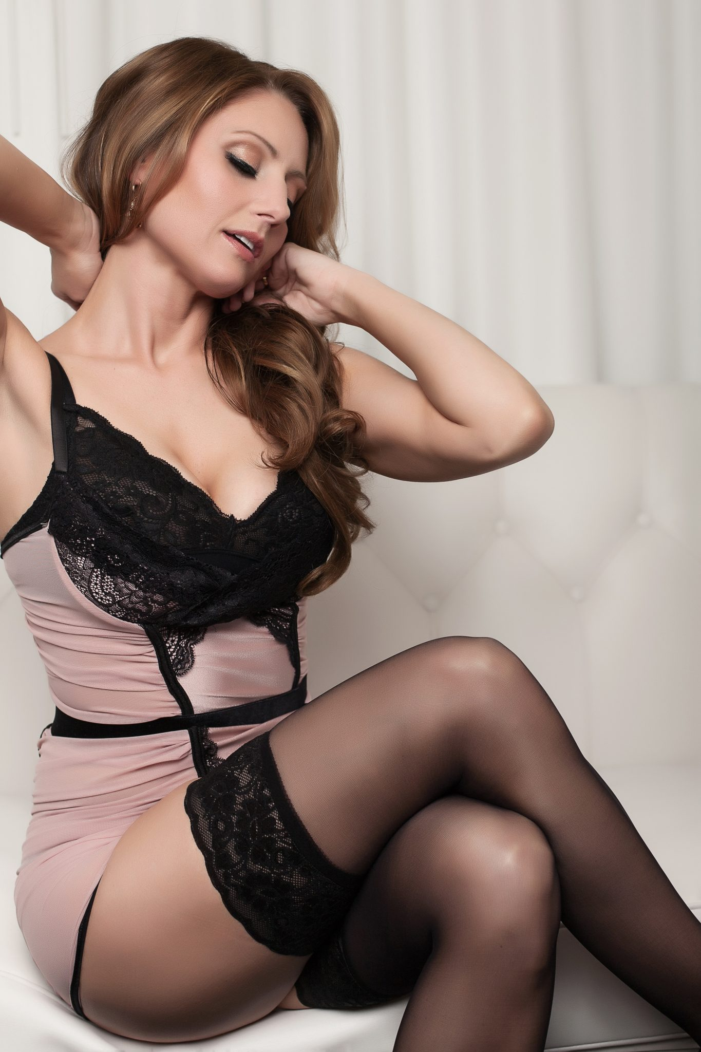 Pretty lingerie and a look of longing. Perfect for a boudoir photography shoot.