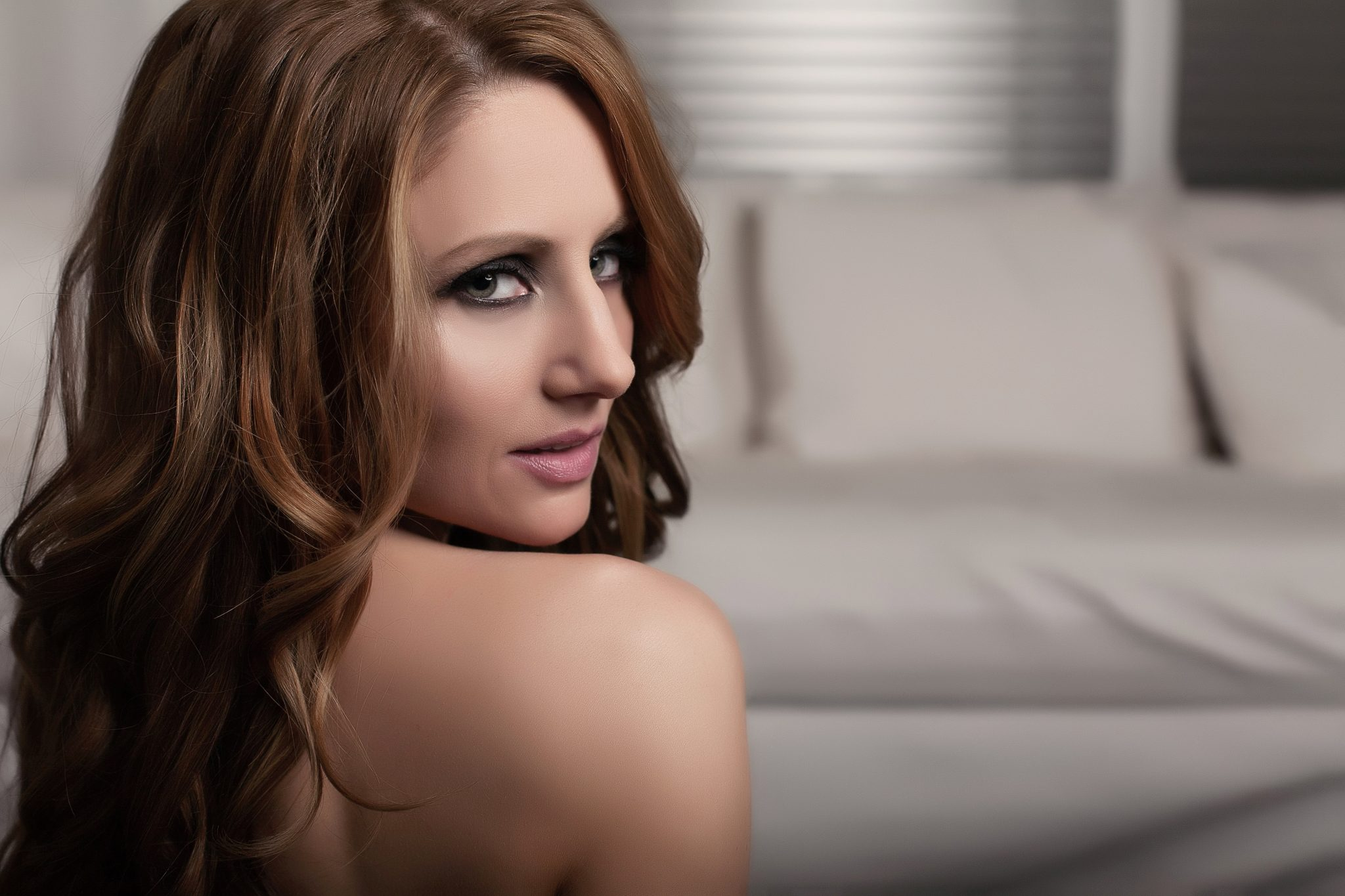 Just a glance is all you need for boudoir photos. No clothing required.
