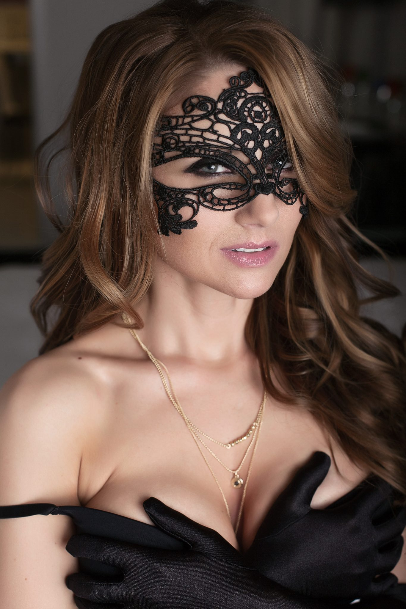 Sexy mask and satin gloves for boudoir photos.