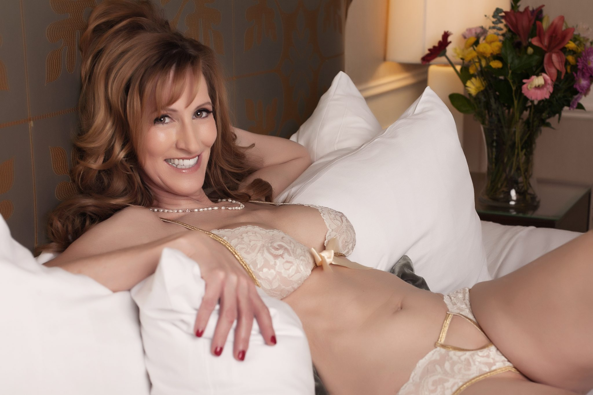 Show your personality with natural expressions. Laugh it up during your boudoir shoot.