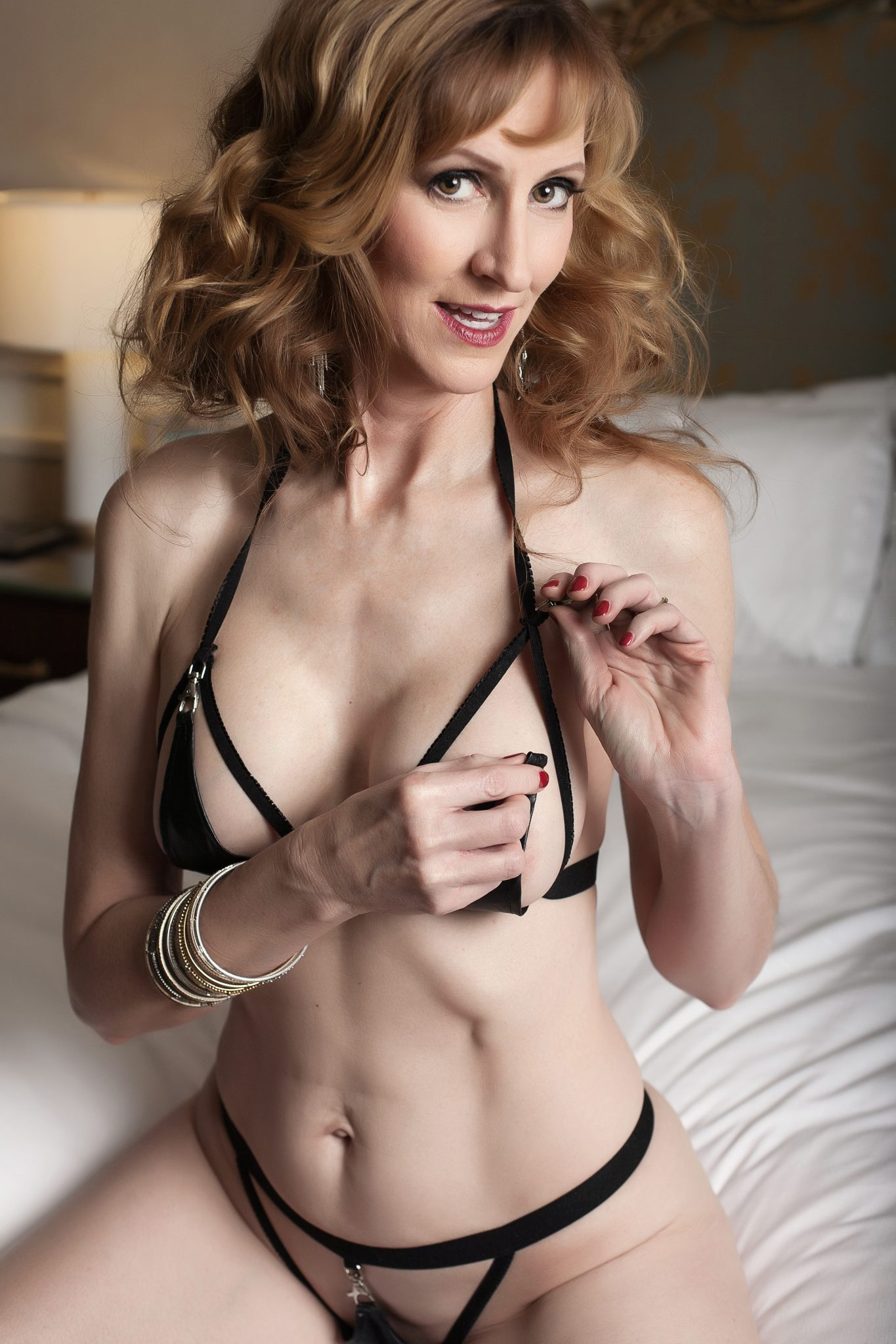 Flirt with the camera and use your lingerie to occupy your hands for boudoir photos.