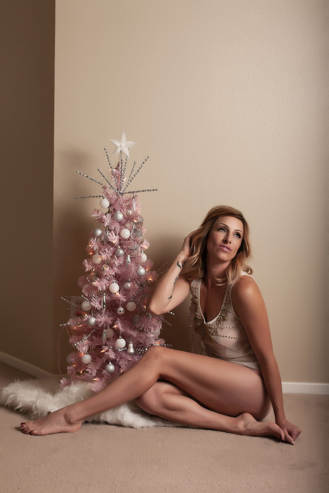 pretty pink christmas tree in this boudoir photo.